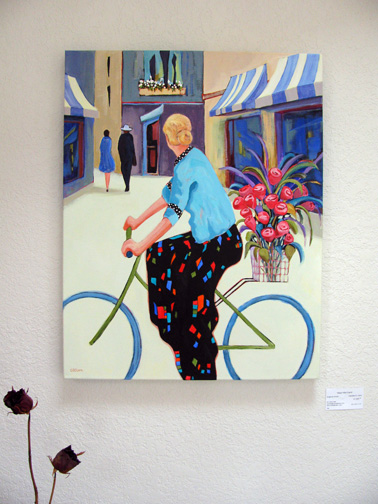 "painting ""Cycling Chic"" by Carolee Clark hanging on the wall"